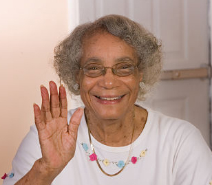 elderly woman waving and smiling